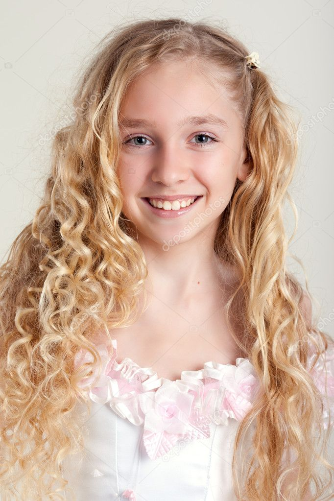Beautiful Little Girl In Dress With Long Hair On Grey