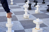 Playing chess outdoors — Stock Photo