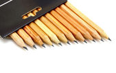 The yellow ground pencils in a black box — Stock Photo