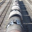 The train transports oil in tanks . - Stock Photo