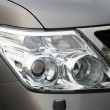 Stock Photo: Closeup of car headlight