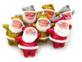 Some dolls of Santa Claus are together — Stock Photo