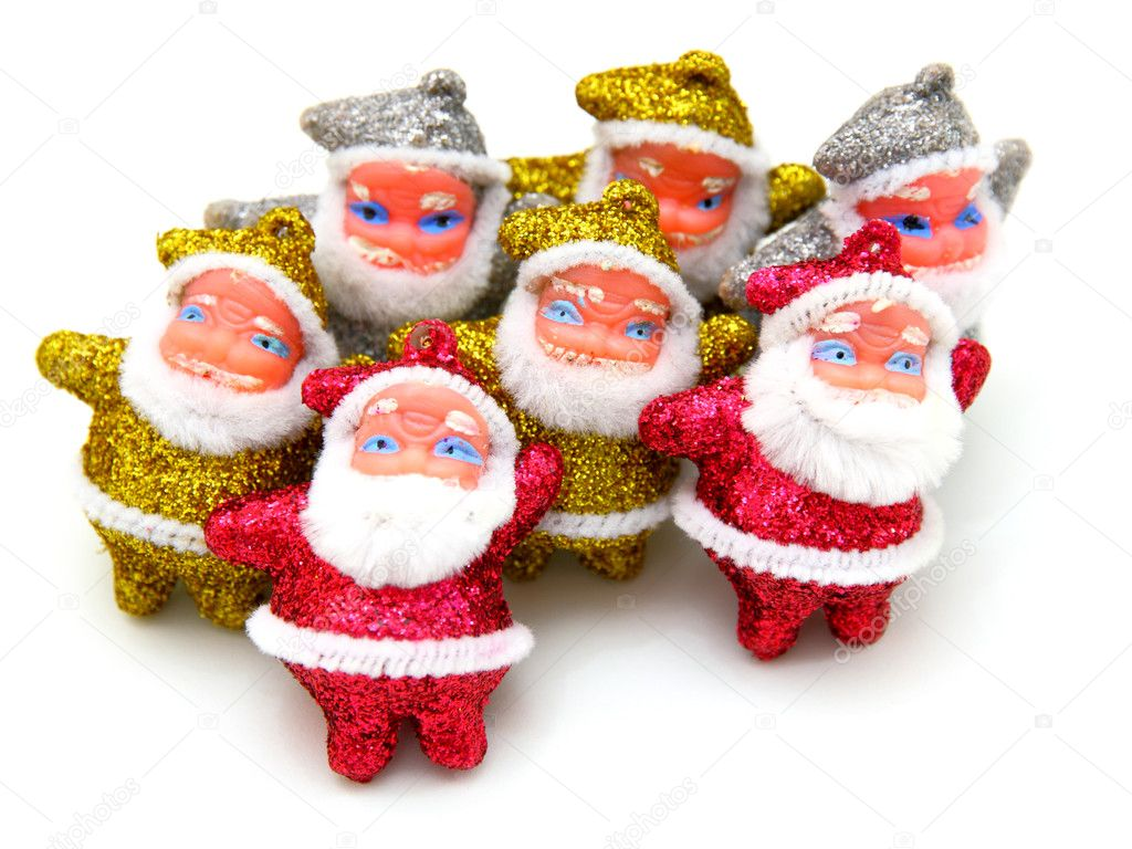 Some dolls of Santa Claus are together isolated on a white background  Stock Photo #4218424