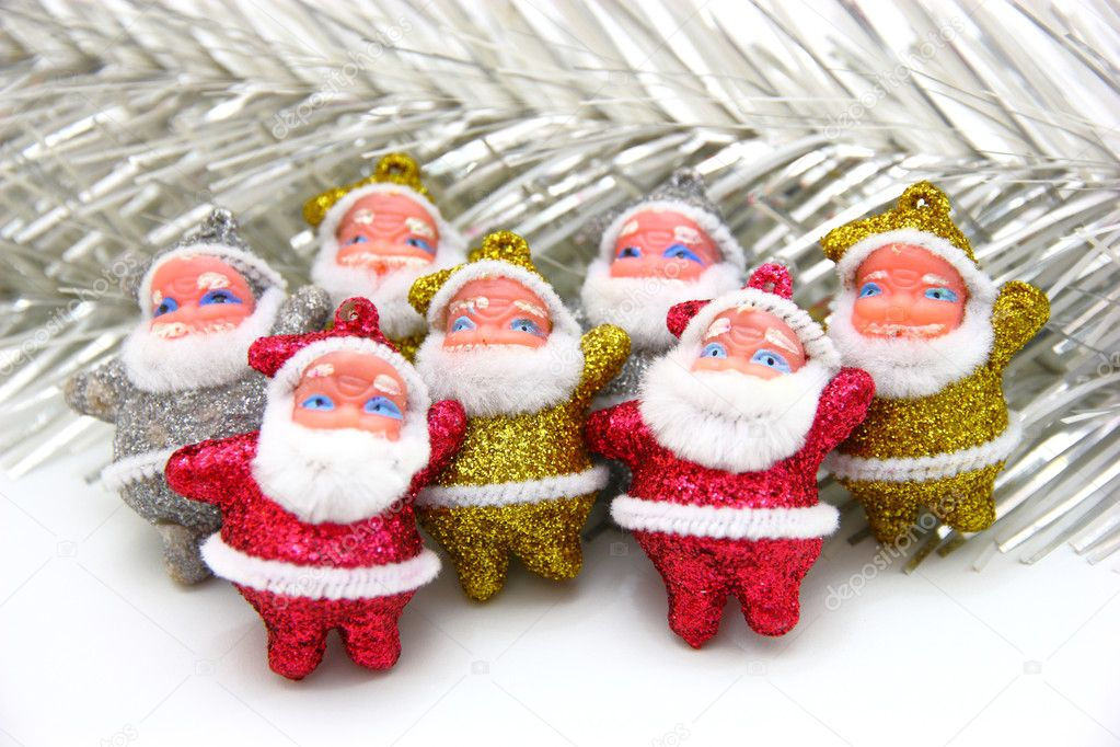 Some dolls of Santa Claus are together isolated on a white background — Stock Photo #4218438