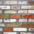 Old wall consisting of bricks of different color — Stock Photo