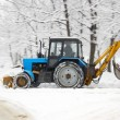 Stock Photo: Tractor removes snow in park