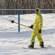 Snowboarder in a yellow suit — Stock Photo #4559768