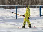 Snowboarder in a yellow suit — Stock Photo