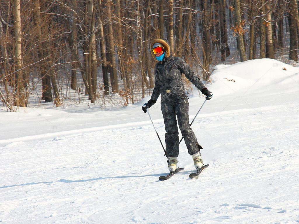The young girl on skis goes from mountain in a spotty suit — Stock Photo #4559730