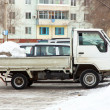 The truck of white color with snow — Stock Photo