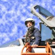 The military pilot in the plane - Stock Photo
