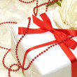 Tender white rose with gift box — Stock Photo