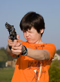 Boy with gun — Stock Photo