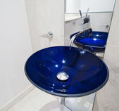 Blue glass hand wash basin — Stock Photo