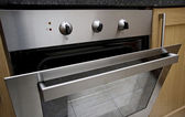 結合された電気オーブン — ストック写真