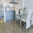 Kitchen with dining table — Stock Photo