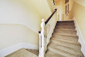 Staircase with wooden rails painted in white — Stock Photo