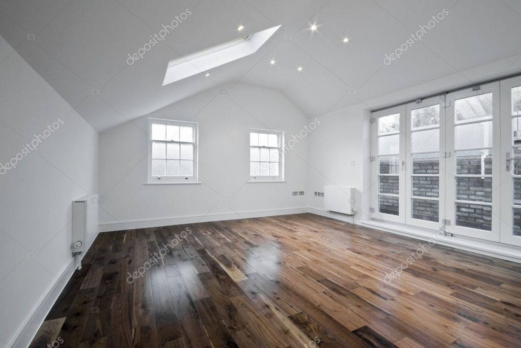 Empty unfurnished loft room with roof window and solid wood floor — Stock Photo #4397031
