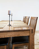 Massive wood dining table — Stock Photo