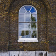 Arched warehouse window - Stock Photo