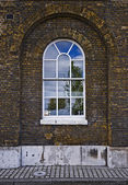 Arched warehouse window — Stock Photo