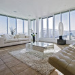 Foto Stock: Massive living room with chunky white sofas