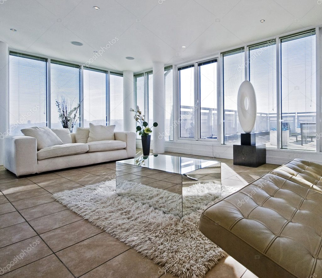 Massive luxury living room with chunky white fabric sofas and floor to ceiling windows — Stock Photo #5202884