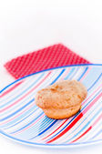 Cake on a plate with stripes — Stock Photo