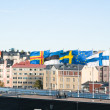 Fluttering Scandinaviflags against sky — Stock Photo #3954919
