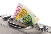 Suitcase with money — Stock Photo