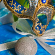 New Year's and Christmas ornaments and a carnival a mask — Photo