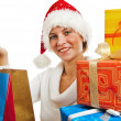 Portrait of the young woman with New Year's gifts, it is isolate — Stock Photo #4313594