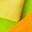 Multi-coloured towels, close up a background — Stock Photo