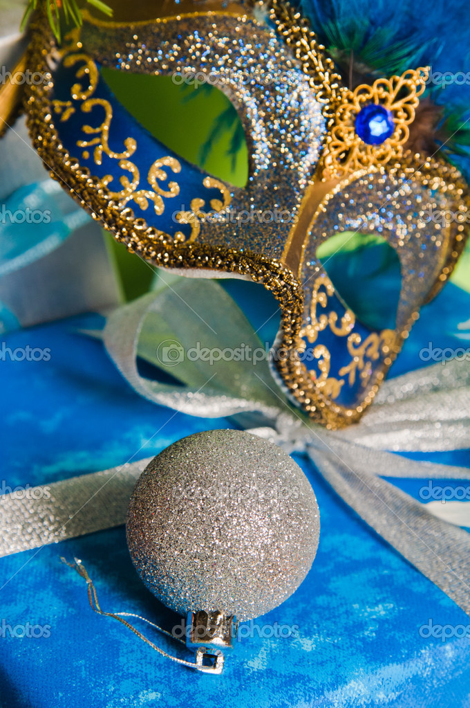 New Year's and Christmas ornaments and a carnival a mask — Stock Photo #4313586