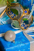 New Year's and Christmas ornaments and a carnival a mask — Stock Photo