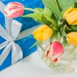 Royalty-Free Stock Photo: Bouquet of tulips and gift
