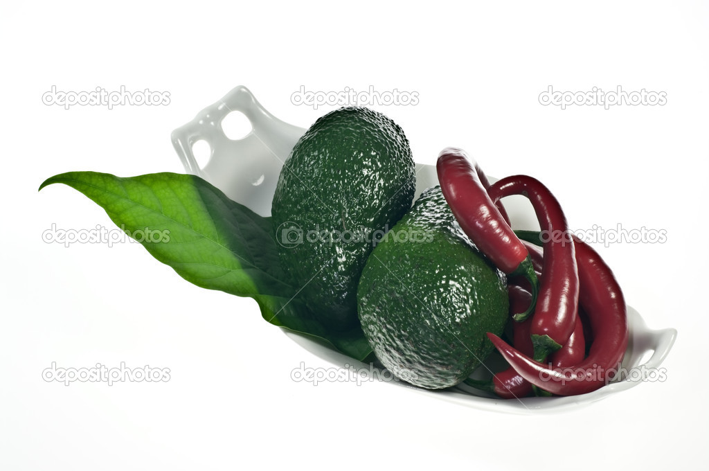 Avocado and red peppers on porcelain dish — Stock Photo #5208026