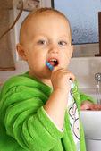 Dental care - small boy washing his teeth — Stock Photo