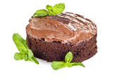 Chocolate cake and mint — Stock Photo