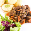 Stewed beef steak with potatoes and salad — Stockfoto