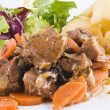 Stewed beef steak with potatoes and salad — Stock Photo #4832306