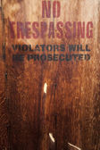 No trespassing on a wood wall — Stock Photo
