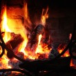 Fire in the fireplace with a lattic — Stock Photo