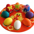 Stock Photo: Plate with colored eggs