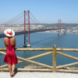 Woman in front of Ponte 25 de Abril — Stock Photo