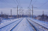 Electric power lines and railway tracks — Stock Photo