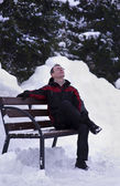 Man on bench in winter — Stock Photo