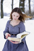 Girl in medieval dress reading the book — Foto de Stock