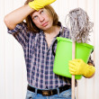 Stock Photo: Tired mwith cleaning supplies