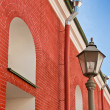 Old building from a red brick and a lantern — Stock Photo #4277488